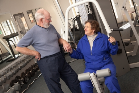 mature old generation: Active Senior Adult Couple Working Out Together in the Gym.