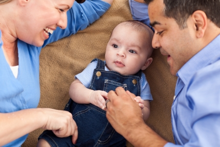 mixed race baby: Mixed Race Family Playing Face Up on the Blanket.