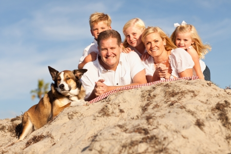 Happy Caucasian Family Portrait at the Beach One Sunny Afternoon. photo