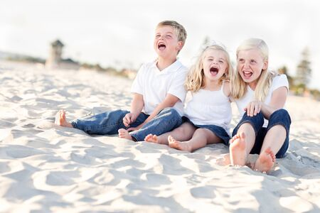 Adorable Sibling Children Portrait at the Beach. photo