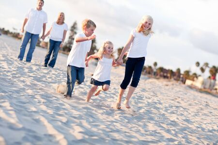 blond boy: Adorable Caucasian Family on a Walk at the Beach.