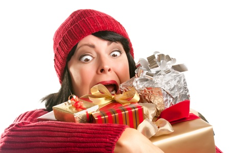 Attractive Woman Fumbling with Her Holiday Gifts Isolated on a White Background. photo