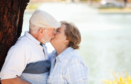 Happy Senior Couple Enjoying Each Other in The Park. Stock Photo