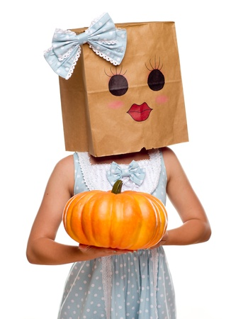 Girl Wearing a Blue Dress and Happy Bag Face Over Her Head Isolated on a White Background.