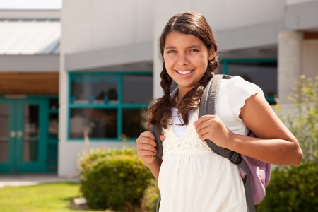 Cute Hispanic Teen Girl Student with Backpack Ready for School. photo