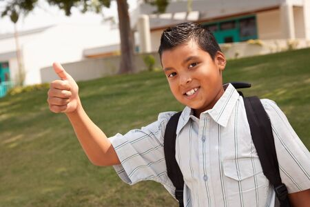 Happy Young Hispanic School Boy with Thumbs Up one Morning. photo