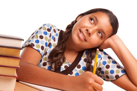 elementary students: Pretty Hispanic Girl Studying and Daydreaming Isolated on a White Background.