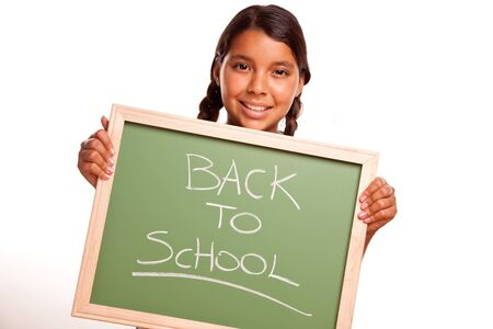 mexican girl: Pretty Hispanic Girl Holding Chalkboard with Back To School Isolated on a White Background.