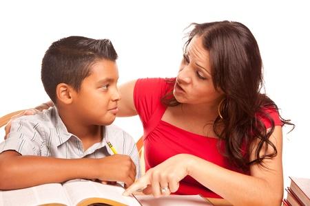Attractive Hispanic Mother and Son Studying Isolated on a White Background. photo