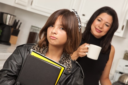 mexican girl: Pretty Hispanic Girl and Mother Getting Ready for School in the Kitchen.