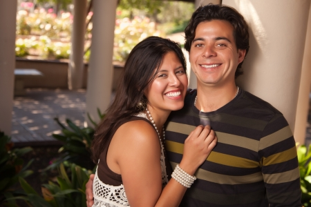 Attractive Hispanic Couple Portrait Enjoying Each Other Outdoors. photo