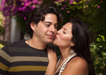 couple having fun: Happy Attractive Hispanic Couple Enjoying Themselves At The Park.