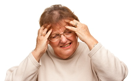 gracious: Senior Woman with Aching Head Isolated on a White Background. Stock Photo