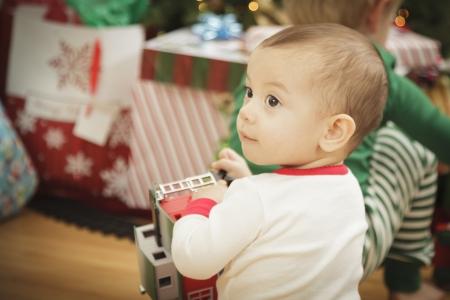 Cute Infant Baby Enjoying Christmas Morning Near The Tree. Stock Photo - 16825722