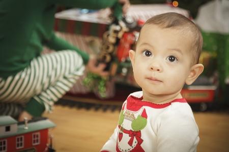 Cute Infant Baby Enjoying Christmas Morning Near The Tree. Stock Photo - 16825715