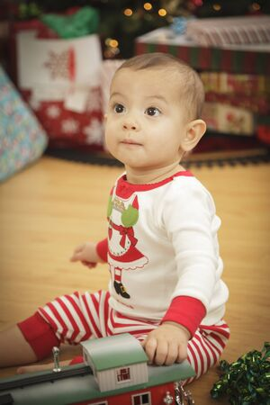Cute Infant Baby Enjoying Christmas Morning Near The Tree. Stock Photo - 16825723