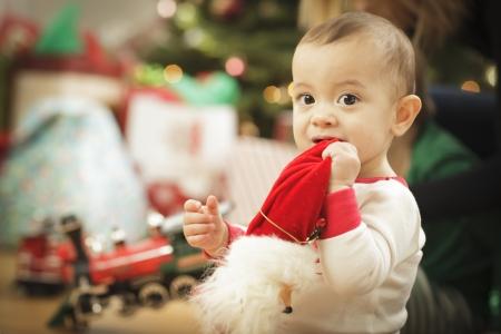 Cute Infant Baby Enjoying Christmas Morning Near The Tree. Stock Photo - 16825735