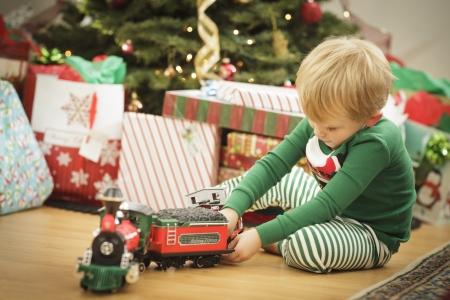Cute Young Boy Enjoying Christmas Morning Near The Tree. Stock Photo - 16825727