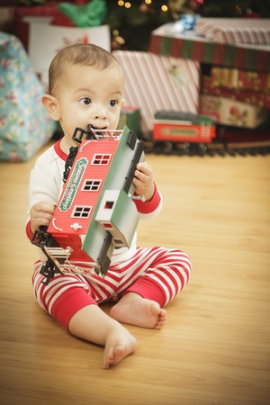 Cute Infant Baby Enjoying Christmas Morning Near The Tree. Stock Photo - 16825729