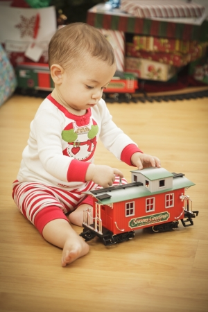 Cute Infant Baby Enjoying Christmas Morning Near The Tree. Stock Photo - 16825725