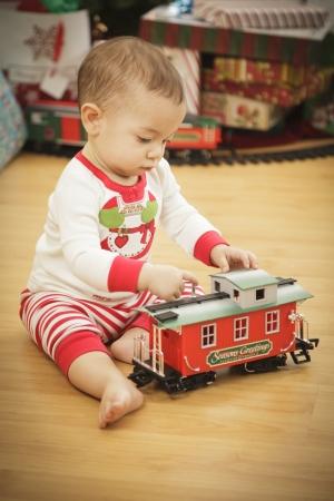Cute Infant Baby Enjoying Christmas Morning Near The Tree. Stock Photo - 16825725
