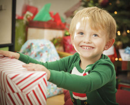 Cute Young Boy Enjoying Christmas Morning Near The Tree. Stock Photo - 16825718