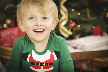 Cute Young Boy Enjoying Christmas Morning Near The Tree. Stock Photo - 16825720