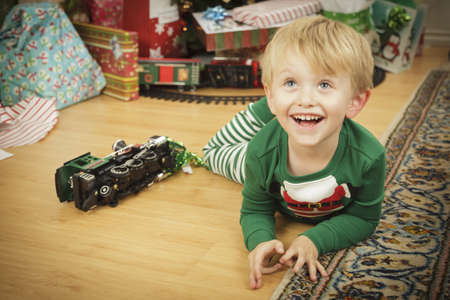Cute Young Boy Enjoying Christmas Morning Near The Tree. Stock Photo - 16825717