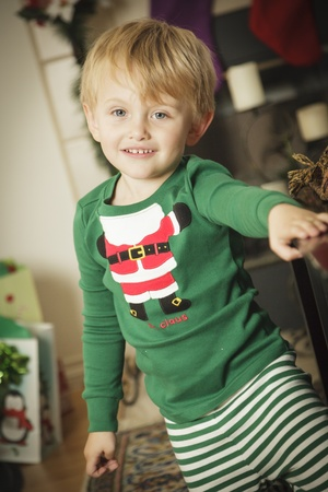 Cute Young Boy Enjoying Christmas Morning Near The Tree. Stock Photo - 16825708