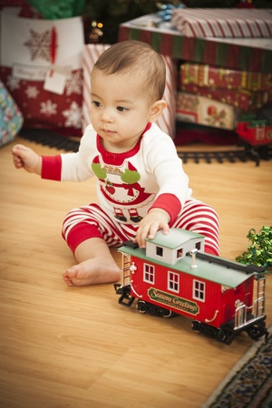 Cute Infant Mixed Race Baby Enjoying Christmas Morning Near The Tree. Stock Photo - 16829998