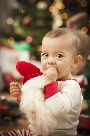 Cute Infant Mixed Race Baby Enjoying Christmas Morning Near The Tree. Stock Photo - 16829983