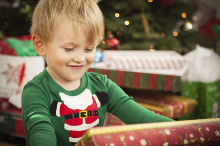 Cute Young Boy Enjoying Christmas Morning Near The Tree. Stock Photo - 16829982