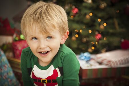 Cute Young Boy Enjoying Christmas Morning Near The Tree. Stock Photo - 16829989