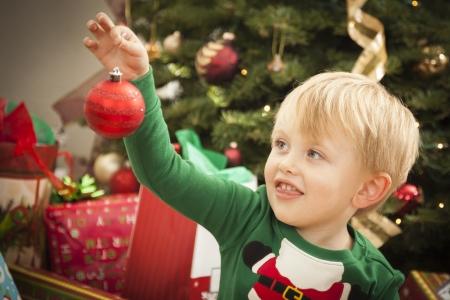 Cute Young Boy Enjoying Christmas Morning Near The Tree. Stock Photo - 16829981