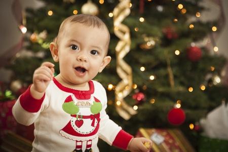 Cute Infant Mixed Race Baby Enjoying Christmas Morning Near The Tree. Stock Photo - 16829996