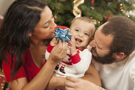 Young Mixed Race Family Portrait Near the Christmas Tree. Stock Photo - 16829984