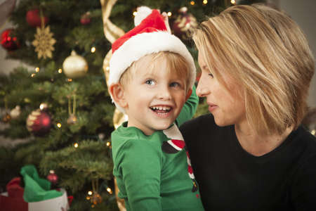 Attractive Young Mother and Baby Son Christmas Portrait. photo