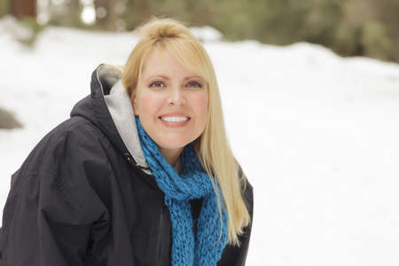 Attractive Woman Having Fun in the Snow on a Winter Day. Stock Photo - 16882512