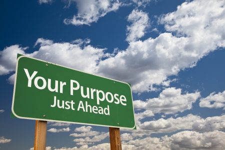 purpose: Your Purpose Green Road Sign Over Dramatic Clouds and Sky. Stock Photo
