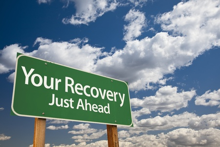 road to recovery: Your Recovery Green Road Sign Over Dramatic Clouds and Sky.