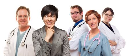 Young Mixed Race Woman with Doctors and Nurses Behind Isolated on a White Background. Stock Photo - 17001782