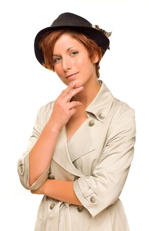 Attractive Red Haired Girl Wearing a Trenchcoat and Hat Isolated on a White Background. Stock Photo - 17001895