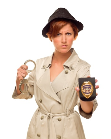 Attractive Female Detective With Handcuffs and Badge In Trenchcoat Isolated on a White Background.