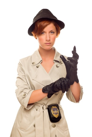 Attractive Female Detective With Badge and Leather Gloves In Trenchcoat Isolated on a White Background. photo