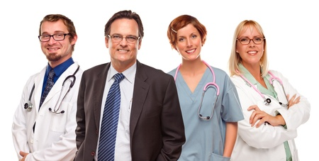 doctors smiling: Smiling Businessman with Male and Female Doctors or Nurses Isolated on a White Background.