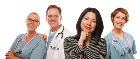 Attractive Hispanic Woman with Male and Female Doctors or Nurses Isolated on a White Background. photo
