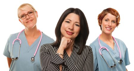 Attractive Hispanic Woman with Female Doctors and Nurses Isolated on a White Background. photo