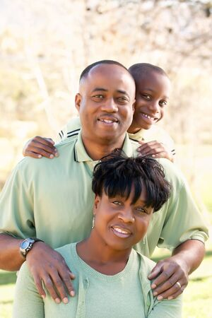african american woman smiling: Beautiful African American Family Portrait Outside Together.