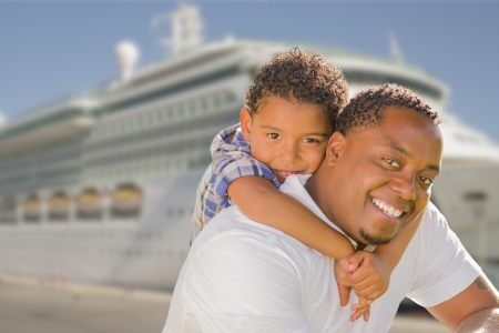 Happy African American Father and Mixed Race Son In Front of Cruise Ship.