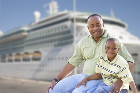 Happy African American Father and Son in Front of Cruise Ship. Stock Photo - 17537715